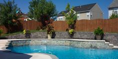 outdoor fireplace built into retaining wall | Pool Retaining Walls