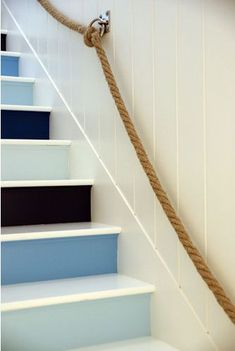 Such a cool idea to bring some beachy, sea colored, nautical themed home decor into your house.  Love the rope and costal colored stairs!
