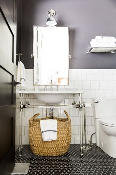 Square tiles with gray grout, black tiled floors. Black and White Bathroom    Studio McGee