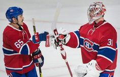 Montreal Canadiens goaltender Carey Price celebrates with teammate Andrew Shaw, left, after defeating the Detroit Red Wings in an NHL hockey game in Montreal, Saturday, Nov. 12, 2016. (Graham Hughes/The Canadian Press via AP)