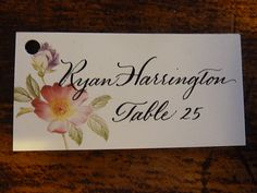 Hand lettered calligraphy place cards and table by iamletterlady