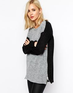 Gray is the color of the season, but black is the color of EVERY season! Combine the two and you're gold.We're planning on wearing a LOT of green over the next few months, and this sweater from Madewell is just the ticket. via @stylelist