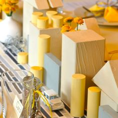 Painted building blocks and hotwheels used as a centerpiece to a baby shower. Too cute!