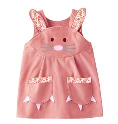 Easter bunny play dress for girls and babies, in soft pink cord with Liberty Print detailA limited edition little girls bunny dress , handmade in softest pink cotton corduroy, with a delightful Liberty print bunny rabbit appliqué face, and cute claw paw pockets.Makes a perfect gift. Watch her hop away, to reveal a cheeky little pom pom tail!