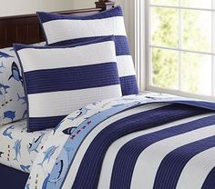 Bold, sporty stripes never go out of style, especially when they're printed in handsome hues. This classic quilt is sewn of pure cotton with a pick-stitched ribbon border. Pure cotton. Polyester batting. Pre-washe