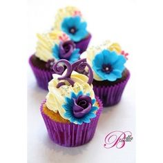 Cupcake wedding cake?  Bright but would match my blue orchid theme