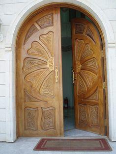 Wood Door with an orange or flower design