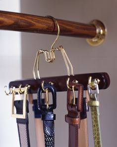To create a belt rack that matches your other hangers (and doesn't require making holds in the wall), try this: Predrill a row of holes in alternating spots on both sides of a wooden clamp hanger, and screw in cup hooks.