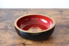 Vintage Japanese lacquered bowl with crane couple the symbol for eternal love and long life hand painted with gold powder.