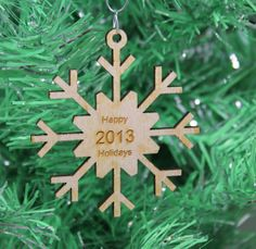 Snowflake Christmas Ornament Happy Holidays 2013 Wood Laser Cut and Engraved on Wanelo $5.00
