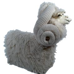 Amazing ram chair with ceramic face and Flokati covered body -- has crochet horns. Crochet horns!