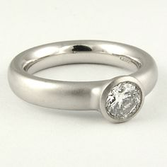 0.50ct GIA F VS2 Round Brilliant diamond in this ultra sleek custom made platinum ring. Designed and handmade in London, for more information see http://www.danielprince.co.uk