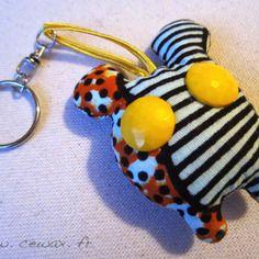 Porte-clés monstre wax motif africain orange, marron et beige (envoi 0€)