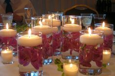 polynesian wedding ideas | Center Pieces :) they just need the sparkly rocks in the bottom and ...