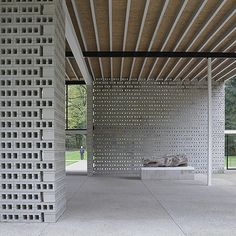 Use of hollow blocks ( concrete here, could be terracotta , jali etc ) as an entire wall - to frame semi indoor outdoor space done very effecively. Possible low cost solution - privacy, windflow, aesthetic, Gerrit Rietveld pavillion at krollermuller museum via paulkomada