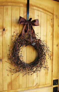I think I may need to try to make this! Fall autum wreath simple and elegant. (can work for any season or occasion by changing color of sprays ribbon and stars)