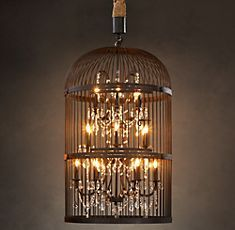 From restoration hardware...I think this could be made. Paint an old birdcage black and hang a small crystal chandelier inside.