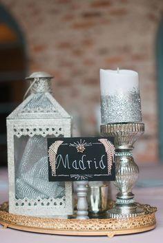Sweet, simple centerpiece with candle and lantern https://www.thecelebrationsociety.com/weddings/gorgeous-spring-wedding-casa-feliz-winter-park-florida/