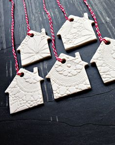 Every Christmas tree needs a tree house right?  This set of five white porcelain house shaped Christmas ornaments will add light hearted style and