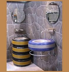 bathroom with old tires   ****I would never guess using old tires this in the house!*****
