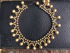 A personal favorite from my Etsy shop https://www.etsy.com/listing/73173463/jingle-bells-gold-brass-beads-bracelet
