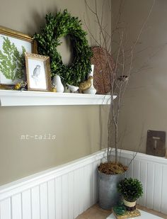 spring bathroom shelf. Love the idea of a shelf somewhere in the house that you can decorate with the seasons.