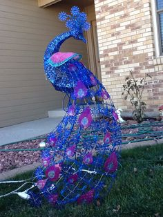 Christmas peacock; one of my birthday gifts. It's beautiful in the daytime and at night!
