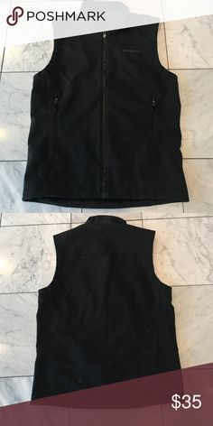 Patagonia vest jacket Men's Patagonia black vest jacket. Size M. Excellent preowned condition. Chest measures 42 inches. And the length measures 27 inches. The material is 93% polyester/7% spandex. All items come from a smoke free environment. Please feel free to make a reasonable offer.  Thank you for shopping in my closet! 😊 Patagonia Jackets & Coats Vests