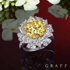 Vivid Elegance This one of a kind exquisite ring features a 5.03 carat Fancy Vivid Yellow central stone and 7.27 carats of white diamonds. #GraffDiamonds #YellowDiamond #Elegance #DiamondRing #FineJewellery
