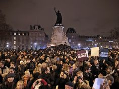 Thousands of people have flooded Paris' Place de la Republique in a vigil to pay tribute to the victims of the attack on satirical magazine Charlie Hebdo.