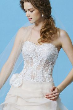 BL048 by Eden Bridal. The top is gorgeous, but don't care too much for the beige-ish colored bottom.