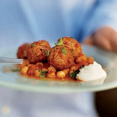 Lamb Meatballs with Red Pepper and Chickpea Sauce | When these meatballs are almost cooked through, Nancy Silverton pushes them to one side of the skillet and adds the chickpeas so everything soaks up the luscious roasted red-pepper sauce.