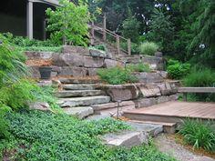 Custom-built stone fixtures in the hillside #backyard #landscaping