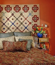 "Quilt designer: Kim Diehl  From American Patchwork & Quilting, October 2002  This quilt is the result of some of Kim's early design experiments. ""It was one of my first attempts to seamlessly merge the quilt center with the border, something that's now very typical of my work,"" she says."