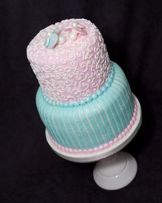 Boy or Girl?  Gender reveal cake.  For more information visit www.cakeglam.com