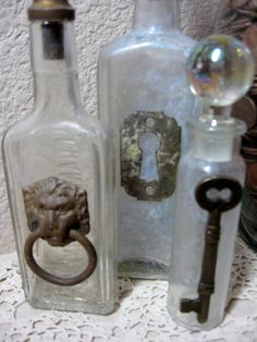 Upcycled Vintage Medicine Bottles Flask Shabby Rustic Collection Brass Stoppers. $32.00, via Etsy.