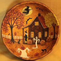 The hand painted original design on this wood bowl features a Halloween folk art scene showing a witch sweeping her porch while her black cats and ghosts play in the yard. Bats flit in the sky lit by a full moon and a witch flies by on her broom.  The bowl is sealed with matte finish and measures approximately 6 inches in diameter and 1 1/2 inches high. The back of the bowl is black. PLEASE NOTE: Each bowl is individually made to order. The one you receive may vary slightly from the one…