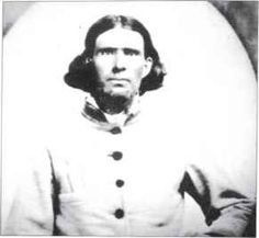 "Captain J.E.McCool, 9th Texas Cavalry; in this reversed image the breast pocket appears on his right rather than his left side -and note the knife hilt protruding from it. The shell jacket has facings at collar and cuffs, and six ""buckeye"" buttons; it closely resembles a surviving example in the Oklahoma Historical Society Collections. (Research Division, Oklahoma Historical Society)"