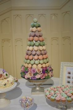Pastel macarons tower as part of a mini dessert table. Lovely idea for a wedding reception.