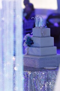 Sprinkles (Orlando, Fl) customized cake with blue orchids added. Cake stand hand made by me. #weddingcake #contemporary #wedding #royalblueandsilverwedding #reception #thefreemans #palomafreeman