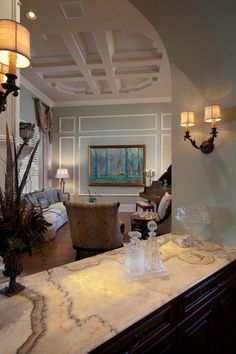 Beautiful living room and marble bar by Dave Brewer, Inc. Use this luxury home for inspiration or purchase at Bella Collina.