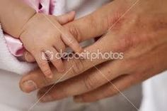 Baby and dad hands
