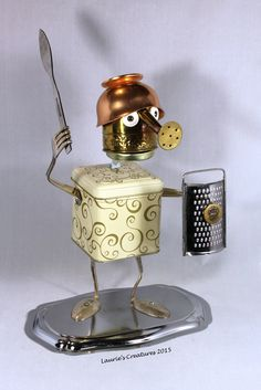 """""""Sir Baylon"""" ~ Original found object/junk art created by Laurie Schnurer in 2015. The tin opens so you can store items inside."""