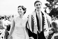 Newlywed Couple is walking from the ceremony | Black & White Photos | Boston Wedding Photographer - Anna Rozenblat | www.AnnasWeddings.com | Inn at Longshore Wedding in Westport, CT