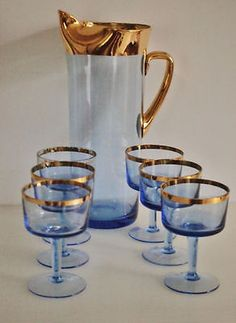 Vintage Cocktail Set - the gold trim is fabulous! These look exactly like the ones my great grandpa gave me :) Makes me smile!