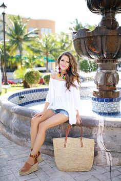 Mexico outfit inspo. love the straw tote and pom pom earrings