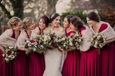 Bridesmaids in Rich Red dresses & cream fur stoles - Image by Lola Rose Photography - A Winter Wedding in a Tipi with Lace Fishtail Annasul Y Wedding Dress, Jenny Packham Headpiece & Rachel Simpson Shoes. Bridesmaids wear Red Dresses & Cream Fur Stole's and Groomsmen in Traditional Morning Suits.