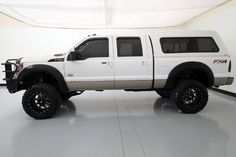 """2014 Ford Super-Duty F-350 SRW King Ranch 4X4 •8"""" Pro Comp Suspension Lift Kit •37"""" Toyo Open Country MT Tires •20"""" Black Fuel Wheels •Amp Powered Running Boards •Black Fender Flares •ARE Paint Matched Locking Camper Top •Front Metal Bumper Guard •Custom F-350 Side Lights •Aftermaket Headlamps •Power Sliding Moonroof •Heated & Cooled Front Seats •Heated Rear Seats •White Platinum Metallic Tri-Coat Exterior •Roof Clearance Lights •Husky Liner Floor Mats •6.7L Power Stroke Turbo Diesel V8…"""