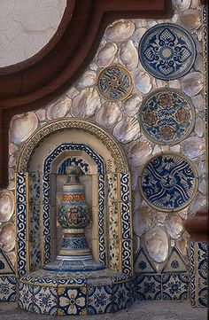 Love how entire plates are embedded as tile, Talavera tile wall from Casa del Risco in San Angel, Mexico