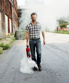 When he takes a casual stroll with a fire extinguisher that is exploding. | 56 Situations Where Andrew Lincoln Looks Absolutely Charming